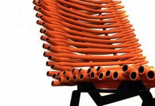 Orange rubber chair seen @ Scrap Lab